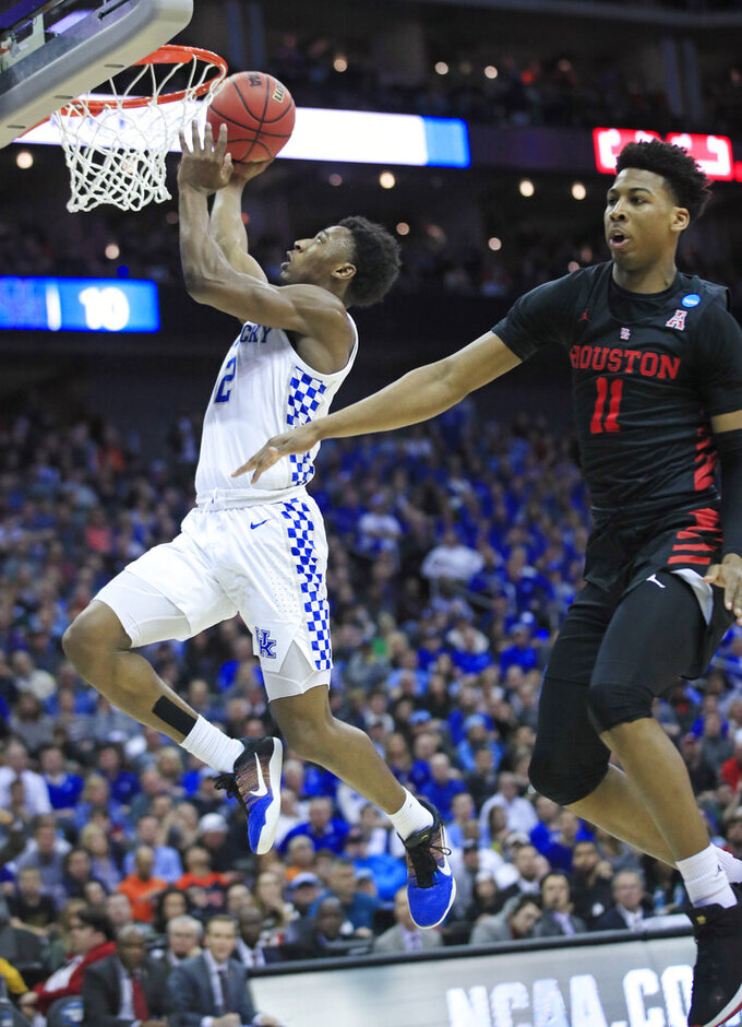 Kentucky's Ashton Hagans (2) heads to the basket past Houston's Nate Hinton (11) during the first half of a men's NCAA tournament college basketball Midwest Regional semifinal game Friday, March 29, 2019, in Kansas City, Mo. (AP Photo/Orlin Wagner)