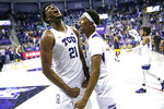 TCU's Kevin Samuel (21) and Diante Smith (10) celebrate following TCU's overtime win over West Virginia in an NCAA college basketball game, Saturday, Feb. 22, 2020 in Fort Worth, Texas. (AP Photo/Ron Jenkins)