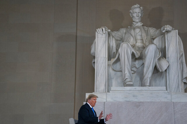 """FILE - In this May 3, 2020, file photo President Donald Trump speaks during a Fox News virtual town hall from the Lincoln Memorial in Washington. Trump repeatedly claimed in the final months of his presidency to have done more for Black Americans than anyone with the """"possible exception"""" of Abraham Lincoln. (AP Photo/Evan Vucci, File)"""