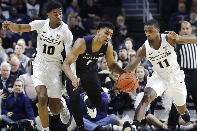 Butler forward Jordan Tucker (1) loses control of the ball between Providence guards Alpha Diallo (11) and A.J. Reeves (10) during the first half of an NCAA college basketball game Friday, Jan. 10, 2020, in Providence, R.I. (AP Photo/Elise Amendola)