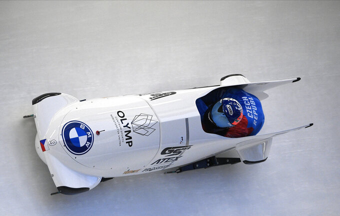 Dominik Dvorak and Jakub Nosek of Czech Republic speed down the track during their first run of the two man Bobsled World Cup race in Sigulda, Latvia, Saturday, Nov. 28, 2020. (AP Photo/Roman Koksarov)