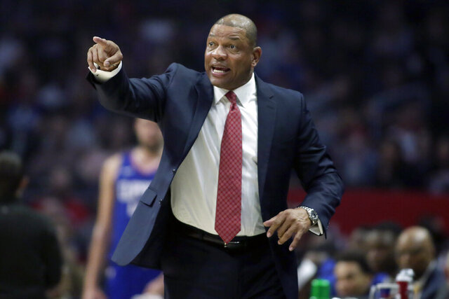 FILE - In this Feb. 1, 2020, file photo, Los Angeles Clippers head coach Doc Rivers talks to his players during the first half of an NBA basketball game against the Minnesota Timberwolves in Los Angeles. (AP Photo/Alex Gallardo, File)