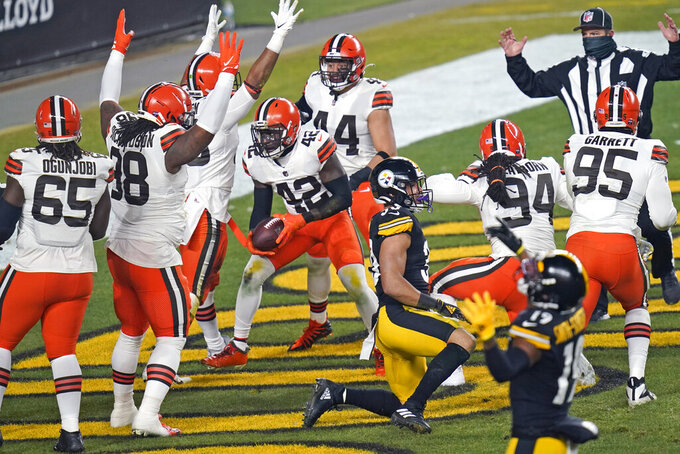 Cleveland Browns strong safety Karl Joseph (42) celebrates after recovering a fumble in the during the first half of an NFL wild-card playoff football game against the Pittsburgh Steelers, Sunday, Jan. 10, 2021, in Pittsburgh. (AP Photo/Keith Srakocic)