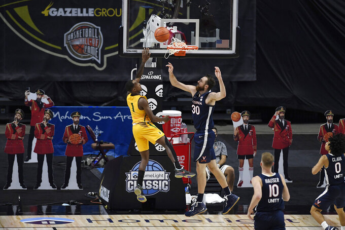San Francisco's Jamaree Bouyea goes up for a basket against Virginia's Jay Huff, right, in the second half of an NCAA college basketball game, Friday, Nov. 27, 2020, in Uncasville, Conn. (AP Photo/Jessica Hill)