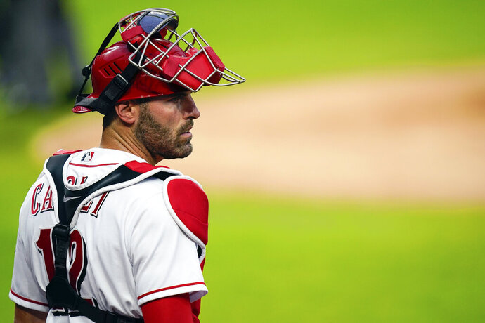 FILE - In this Monday, July 27, 2020, file photo, Cincinnati Reds catcher Curt Casali (12) stands on the field during a baseball game against the Chicago Cubs in Cincinnati. Casali agreed to a $1.5 million, one-year contract with the San Francisco Giants on Monday, Jan. 4, 2021, a month after he was cut by the Reds. (AP Photo/Bryan Woolston, File)