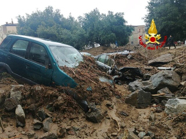 Cars among other debris litter the street in Bitti, Sardinia, Italy, Sunday, Nov. 29, 2020.  The town of Bitti in Sardinia was hit by a storm and flooded by a massive mudslide on Saturday. (Vigili del Fuoco via AP)