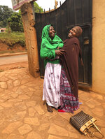 This photo provided by her daughter shows Fadumo Hussein, right, with her 75-year-old mother, Halima Shobe, during a trip to Africa in December 2017. Though the Trump administration's travel ban has made it difficult for refugees from Somalia to come to the U.S., Hussein is still hoping her parents, who have health problems, can eventually join her in Ohio one day. (AP Photo/Afnan Salem)