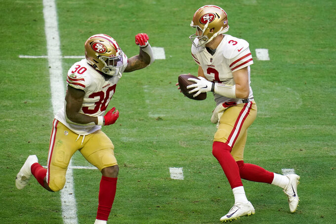 San Francisco 49ers quarterback C.J. Beathard (3) fakes a handoff to running back Jeff Wilson (30) an NFL football game against the Seattle Seahawks, Sunday, Jan. 3, 2021, in Glendale, Ariz. (AP Photo/Ross D. Franklin)