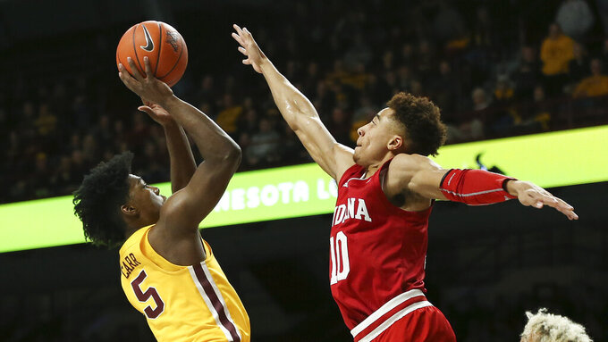 Minnesota's Marcus Carr shoots as Indiana's Rob Phinisee defends during the first half of an NCAA college basketball game Wednesday, Feb. 19, 2020, in Minneapolis. (AP Photo/Stacy Bengs)