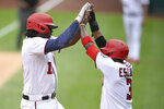 Washington Nationals' Josh Bell, left, celebrates his two-run home run with Alcides Escobar, right, during the first inning of a baseball game against the New York Mets, Sunday, Sept. 5, 2021, in Washington. (AP Photo/Nick Wass)