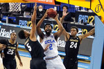 UCLA forward Cody Riley (2) shoots over Colorado guard D'Shawn Schwartz (5) and guard Eli Parquet (24) during the second half of an NCAA college basketball game Saturday, Jan. 2, 2021, in Los Angeles. (AP Photo/Marcio Jose Sanchez)