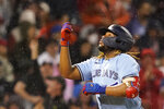 Toronto Blue Jays' Vladimir Guerrero Jr. celebrates after hitting a three-run home run during the fifth inning of the team's baseball game against the Boston Red Sox at Fenway Park, Thursday, July 29, 2021, in Boston. (AP Photo/Elise Amendola)