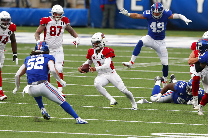 Arizona Cardinals quarterback Kyler Murray, center carries the ball through New York Giants defenders during the second half of an NFL football game, Sunday, Dec. 13, 2020, in East Rutherford, N.J. (AP Photo/Noah K. Murray)