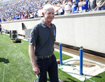 """Retired airline captain Chesley """"Sully"""" Sullenberger heads off the field after taking part in the ceremonial coin toss before Air Force hosts Stony Brook in the first half of an NCAA college football game Saturday, Sept. 1, 2018, at Air Force Academy, Colo. (AP Photo/David Zalubowski)"""