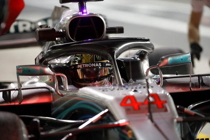 Mercedes driver Lewis Hamilton of Britain steers his car during the second free practice at the Yas Marina racetrack in Abu Dhabi, United Arab Emirates, Friday Nov. 23, 2018. The Emirates Formula One Grand Prix will take place on Sunday. (AP Photo/Luca Bruno)
