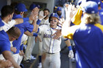 Seattle Mariners' Jarred Kelenic celebrates in the dugout after hitting a solo home run during the sixth inning of a baseball game against the Kansas City Royals, Sunday, Aug. 29, 2021, in Seattle. (AP Photo/Jason Redmond)