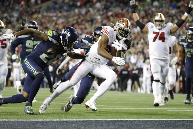 San Francisco 49ers' Raheem Mostert scores against the Seattle Seahawks during the second half of an NFL football game, Sunday, Dec. 29, 2019, in Seattle. (AP Photo/Ted S. Warren)