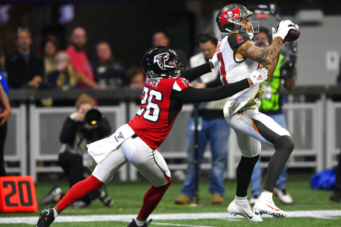 Tampa Bay Buccaneers wide receiver Mike Evans (13) makes the catch against Atlanta Falcons cornerback Isaiah Oliver (26) during the first half of an NFL football game, Sunday, Nov. 24, 2019, in Atlanta. (AP Photo/John Amis)