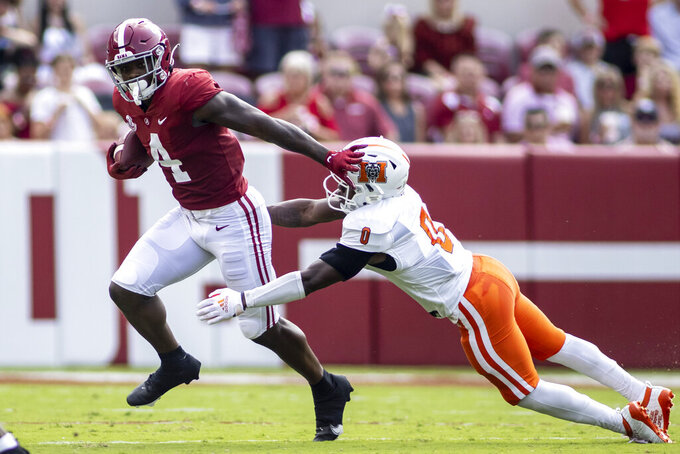 Alabama running back Brian Robinson Jr. (4) runs past Mercer defensive back Lance Wise (0) during the first half of an NCAA college football game, Saturday, Sept. 11, 2021, in Tuscaloosa, Ala. (AP Photo/Vasha Hunt)