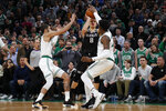 Sacramento Kings' Bogdan Bogdanovic goes for a winning shot in the final seconds, which he missed, while guarded by Boston Celtics' Jayson Tatum, left, and Robert Williams III during the fourth quarter of an NBA basketball game Monday, Nov. 25, 2019, in Boston. (AP Photo/Winslow Townson)