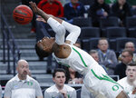 Oregon's Kenny Wooten tries to keep the ball in play during the first half of the team's NCAA college basketball game against Washington State in the first round of the Pac-12 men's tournament Wednesday, March 13, 2019, in Las Vegas. (AP Photo/John Locher)