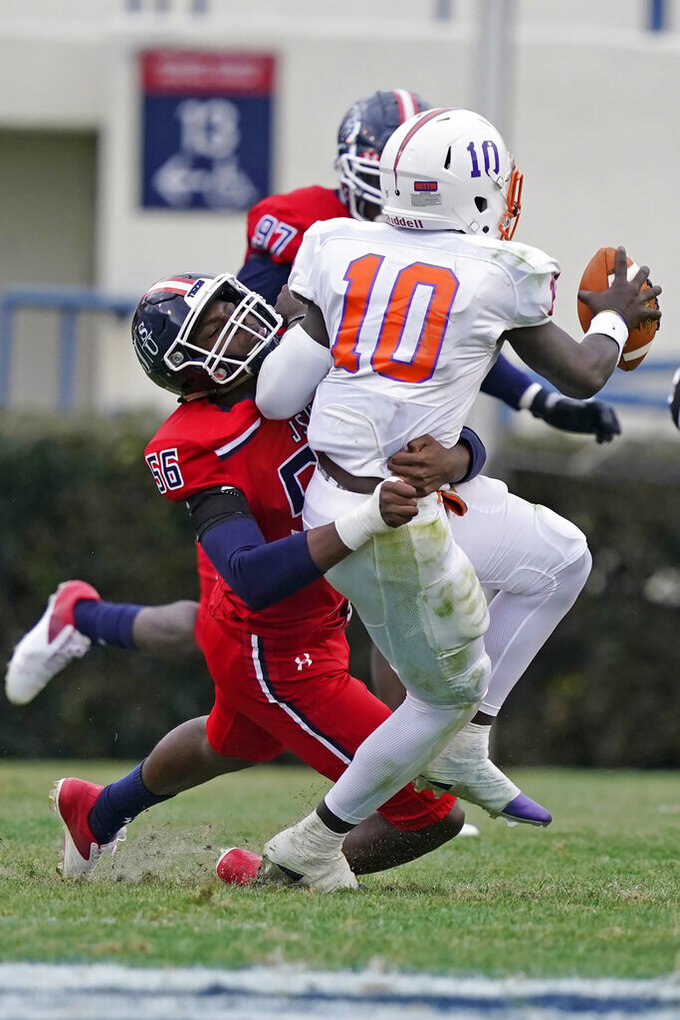 Jackson State linebacker Keith Lopez (56) sacks Edward Waters quarterback Roshard Branch (10) during the second half of an NCAA college football game in Jackson, Miss., Sunday, Feb. 21, 2021. (AP Photo/Rogelio V. Solis)