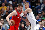 Toronto Raptors center Marc Gasol (33) works against Dallas Mavericks forward Kristaps Porzingis, right, in the second half of an NBA basketball game in Dallas, Saturday, Nov. 16, 2019. (AP Photo/Tony Gutierrez)