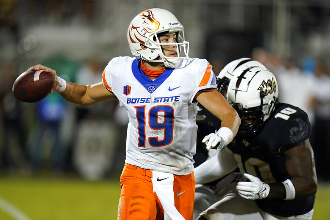 Boise State quarterback Hank Bachmeier (19) throws a pass as he is pressured by Central Florida linebacker Eriq Gilyard (10) during the first half of an NCAA college football game Thursday, Sept. 2, 2021, in Orlando, Fla. (AP Photo/John Raoux)