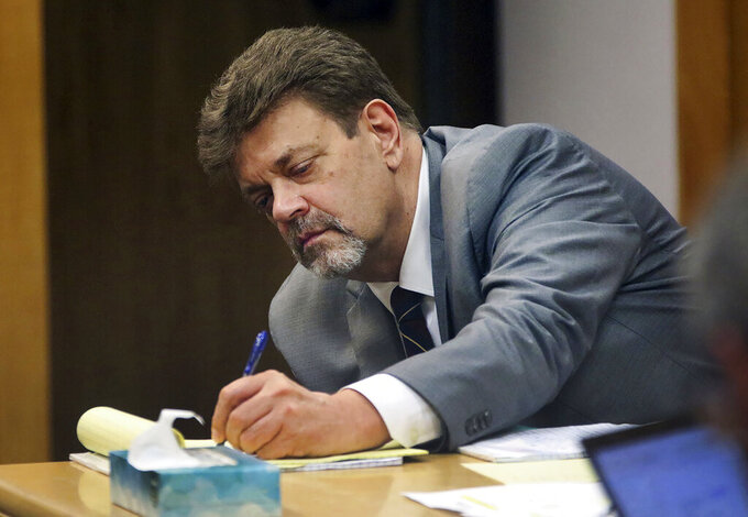 FILE - In this June 29, 2021, file photo, Mark Redwine takes notes as a former sheriff's investigator, testifies during his trial in Durango, Colo. Redwine was convicted by a jury on Friday, July 16, 2021, of second-degree murder and child abuse resulting in death in the 2012 disappearance of his 13-year-old son. (Jerry McBride/The Durango Herald via AP, File)