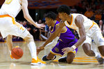 Tennessee Tech guard J.R. Clay (4) and Tennessee forward Kyle Alexander (11) scramble for the ball in the first half of an NCAA college basketball game Saturday, Dec. 29, 2018, in Knoxville, Tenn. (AP Photo/Shawn Millsaps)