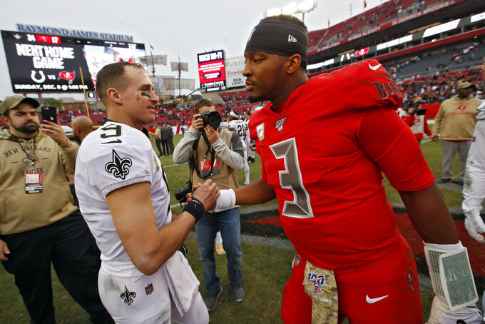 New Orleans Saints quarterback Drew Brees, left, shakes hands with Tampa Bay Buccaneers quarterback Jameis Winston after an NFL football game Sunday, Nov. 17, 2019, in Tampa, Fla. (AP Photo/Mark LoMoglio)