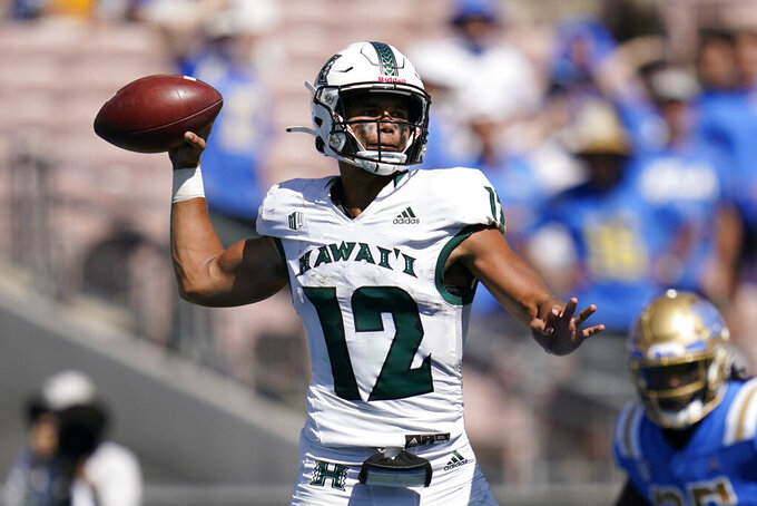 Hawaii quarterback Chevan Cordeiro (12) throws a pass during the second half of an NCAA college football game against UCLA Saturday, Aug. 28, 2021, in Pasadena, Calif. (AP Photo/Ashley Landis)