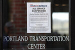 In this Wednesday, May 13, 2020 photo, a sign announces the suspension of service of Concord Coach Lines at a transportation center in Portland, Maine. America's private buses are ground to a halt, and members of the industry say they need federal assistance to help the country get back to work and play.  (AP Photo/Robert F. Bukaty)