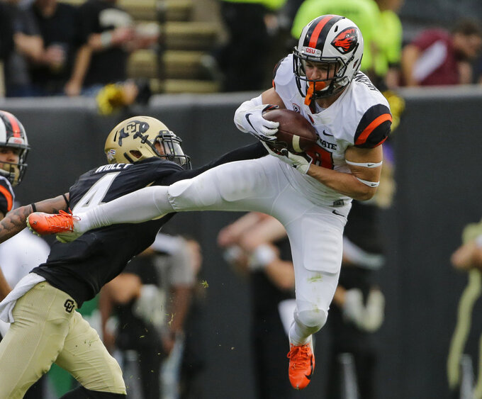 Oregon State wide receiver Timmy Hernandez (18) catches a pass as Colorado defensive back Dante Wigley (4) defends during the second half of an NCAA college football game, Saturday, Oct. 27, 2018, in Boulder, Colo. (AP Photo/Jack Dempsey)