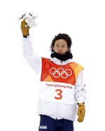 Silver medal winner Ayumu Hirano, of Japan, celebrates after the men's halfpipe finals at Phoenix Snow Park at the 2018 Winter Olympics in Pyeongchang, South Korea, Wednesday, Feb. 14, 2018. (AP Photo/Gregory Bull)
