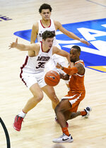 Texas guard Matt Coleman III (2) reaches for a loose ball against Davidson forward Luka Brajkovic (35) and Davidson guard Kellan Grady (31) in the second half of an NCAA college basketball game in the Maui Invitational tournament, Monday, Nov. 30, 2020 in Asheville, N.C. Texas won 78-76. (AP Photo/Kathy Kmonicek)