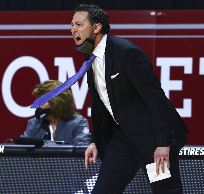 Grand Canyon's head coach Bryce Drew directs his team during the first half of an NCAA college basketball game against New Mexico State for the championship of the Western Athletic Conference men's tournament Saturday, March 13, 2021, in Las Vegas. (AP Photo/Chase Stevens)