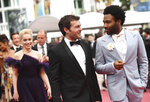Actors Emilia Clarke, from left, Alden Ehrenreich, and Donald Glover pose for photographers upon arrival at the premiere of the film 'Solo: A Star Wars Story' at the 71st international film festival, Cannes, southern France, Tuesday, May 15, 2018. (Photo by Arthur Mola/Invision/AP)