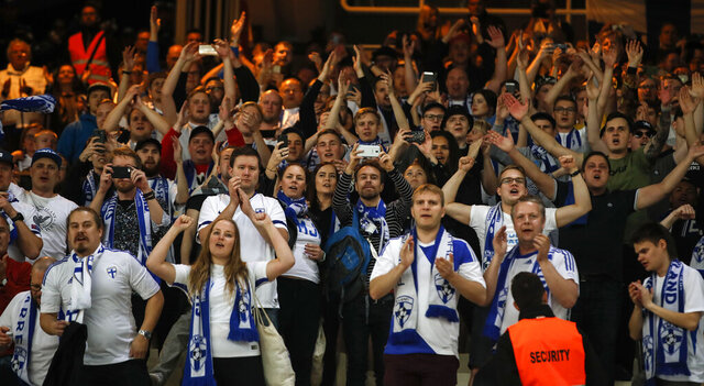 FILE - In this file photo taken on Nov. 18, 2019, Finland supporters applaud their team after the Euro 2020 group J qualifying soccer match between Greece and Finland at Olympic stadium in Athens, Greece. A stellar 2019 for soccer in Finland was meant to hit a new peak in the 2020 season. The national team qualified last November for its first major tournament and Finland was going to spend mid-June obsessed by the European Championship. (AP Photo/Thanassis Stavrakis)