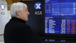 A man watches the public display boards at the Australian Stock Exchange in Sydney, Thursday, Aug. 15, 2019. Asian stock markets followed Wall Street lower on Thursday after the Dow Jones Industrial Average plunged on mounting fears of a possible recession. (AP Photo/Rick Rycroft)