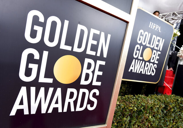 """FILE - This Jan. 6, 2019 file photo shows Golden Globes signage on the red carpet at the 76th annual Golden Globe Awards in Beverly Hills, Calif. The Golden Globes will accept movies submissions without a theatrical release for the first time due to the coronavirus pandemic, the Hollywood Foreign Press Association announced Thursday. The press association said the eligibility change was temporary and would last from March 15 to April 30, """"with this period subject to later review and extension.""""  (Photo by Jordan Strauss/Invision/AP, File)"""