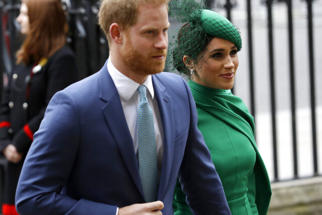 FILE - In this Monday, March 9, 2020 file photo, Britain's Harry and Meghan the Duke and Duchess of Sussex arrive to attend the annual Commonwealth Day service at Westminster Abbey in London. Prince Harry has repaid 2.4 million pounds ($3.2 million) in British taxpayers' money that was used to renovate the home intended for him and his wife Meghan before they gave up royal duties. A spokesman on Monday, Sept. 7, 2020 Harry has made a contribution to the Sovereign Grant, the public money that goes to the royal family. (AP Photo/Kirsty Wigglesworth, file)