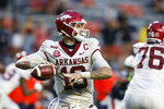 FILE - In this Oct. 10, 2020, filer photo, Arkansas quarterback Feleipe Franks looks for a receiver during the second half of the team's NCAA college football game against Auburn, in Auburn, Ala. His eight touchdown passes are already more than any Arkansas QB threw last year. (AP Photo/Butch Dill, File)