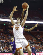 Texas center Will Baker (50) drives to the basket against TCU during the second half of an NCAA college basketball game in Austin, Texas, Wednesday, Feb. 19, 2020. (AP Photo/Eric Gay)