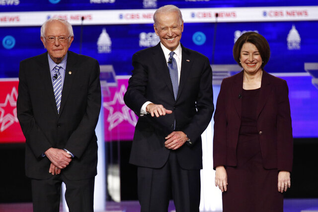 From left, Democratic presidential candidates,  Sen. Bernie Sanders, I-Vt., former Vice President Joe Biden, and Sen. Amy Klobuchar, D-Minn., stand on stage before a Democratic presidential primary debate at the Gaillard Center, Tuesday, Feb. 25, 2020, in Charleston, S.C., co-hosted by CBS News and the Congressional Black Caucus Institute. (AP Photo/Patrick Semansky)