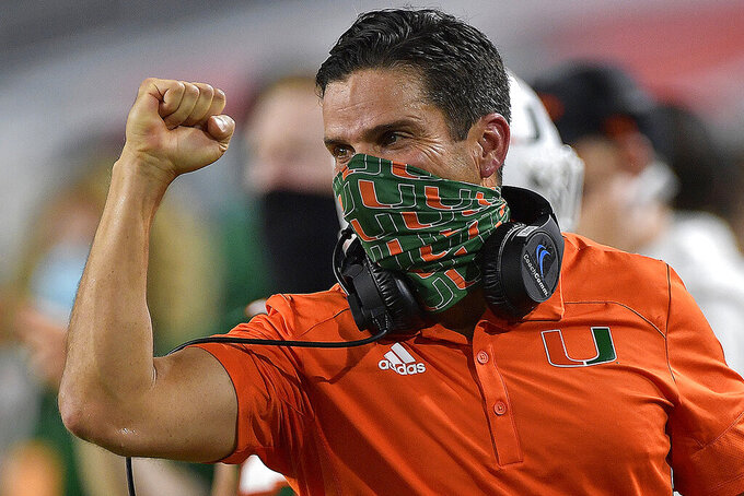 FILE - In this Saturday, Sept. 26, 2020, file photo, Miami head coach Manny Diaz celebrates a touchdown against Florida State during the first half of an NCAA college football game, in Miami Gardens, Fla. The competition isn't as formidable this week for the Miami Hurricanes, and that has their coach concerned. After losing last week at No. 1 Clemson, Miami will try to rebound Saturday against Pittsburgh. (Michael Laughlin/South Florida Sun-Sentinel via AP, File)
