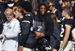 Injured Colorado wide receiver Laviska Shenault Jr. jokes with teammates in the first half of an NCAA college football game against Arizona Saturday, Oct. 5, 2019, in Boulder, Colo. (AP Photo/David Zalubowski)