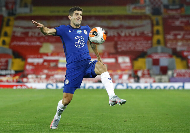 Chelsea's Christian Pulisic controls the ball during the English Premier League soccer match between Liverpool and Chelsea at Anfield Stadium in Liverpool, England, Wednesday, July 22, 2020. (Phil Noble/Pool via AP)