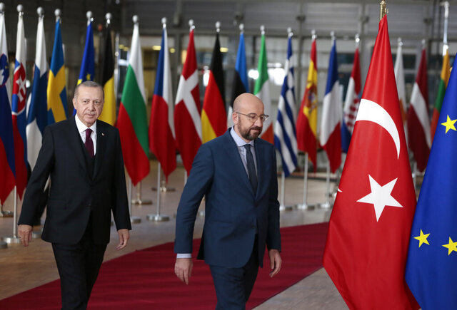 Turkish President Recep Tayyip Erdogan, left, walks with European Council President Charles Michel prior to a meeting at the European Council building in Brussels, Monday, March 9, 2020. Turkish President Recep Tayyip Erdogan will visit Brussels on Monday for talks with European Union officials amid a standoff between Ankara and Brussels over sharing of responsibility for refugees and migrants. (AP Photo/Virginia Mayo)