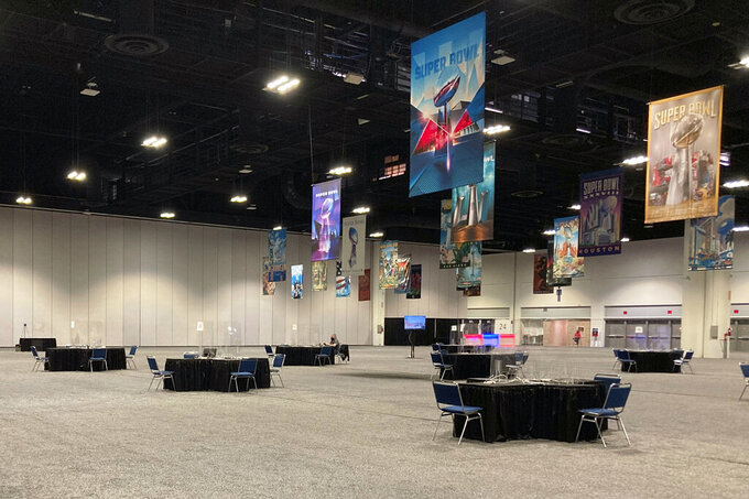 Radio row at the Super Bowl is nearly empty Saturday, Feb. 6, 2021, inside the Tampa Convention Center in Tampa, Fla. Radio row, usually one of the most happening spots during the week, reaching peak levels on Thursday and Friday as players, celebrities and entertainers bounce from one interview to another, promoting whatever brand paid them to be there, was nearly empty due to COVID-19. (AP Photo/Rob Maaddi)